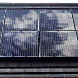 A close up of black solar panel installation